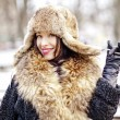 Joyfull russian woman in fur hat and coat — Stock Photo