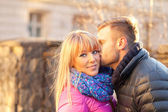 Young man kissing a beautiful woman — Stock Photo