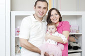Mother and father with dauther — Stock Photo