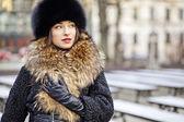 Winter girl posing in park — Stock Photo
