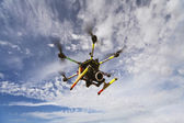 Octocopter drone flying with camera — Stock Photo