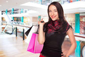 Young woman shopping in the mall — Stock Photo