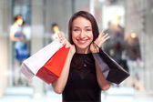 Shopping Girl with showcase background — Stok fotoğraf