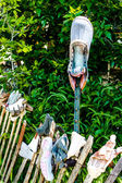 Garden Fence of Old Shoes, Boots and Gloves — Stock Photo