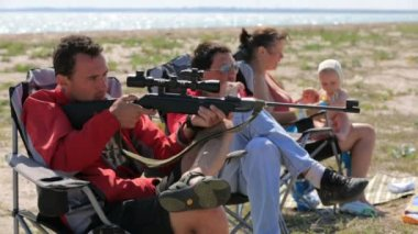 Man with air rifle shooting — Stock Video