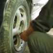 Stock Video: Tire disassembling.