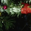 Close up of christmas decorations on a fir tree branch — Stock Video #33816199