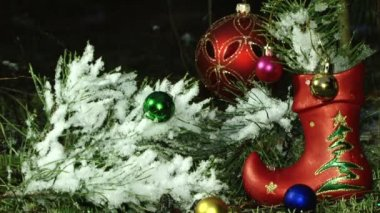 Close up of christmas decorations on a fir tree branch — Stock Video