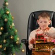 Young boy with Christmas gifts — Video