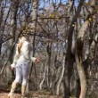 Woman walking in autumn park — Stock Video