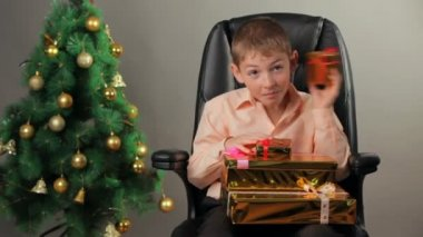 Young boy with Christmas gifts — Stock video