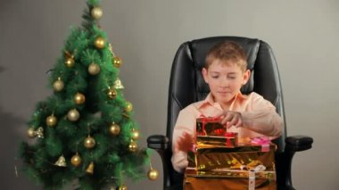 Young boy with Christmas gifts — 图库视频影像