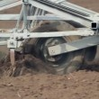 Stock Video: Plows Cultivating Soil. Slow Motion.