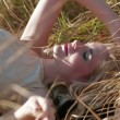 Stock Video: Girl Lies On Grass