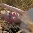 Stock Video: Cute Girl Lying On Grass
