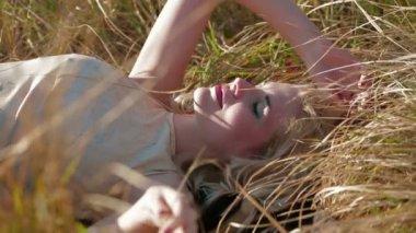 Girl Lies On Grass — Stock Video