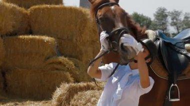 Girl Caresses Horse — Stock Video