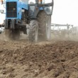 Stock Video: Tractor Cultivating Field. Slow motion.
