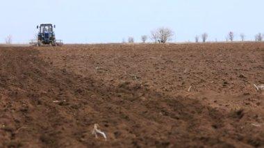 Tractor Cultivates Farmland — Стоковое видео