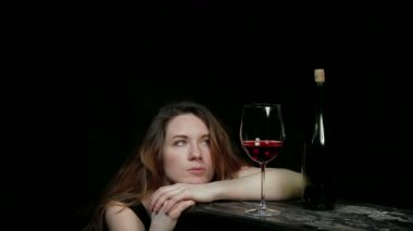 Sad young woman drinking wine alone. — Stock Video