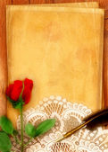 Red Rose and Parchment — Stock Photo