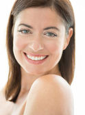 Attractive woman in her forties with bare shoulders — Stock Photo