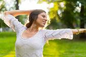 Woman feeling freedom at sunset — Stock Photo