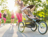 Active mother jogging — Stock Photo