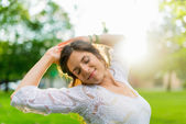 Mixed race woman feeling freedom in a sun flare — Stock Photo