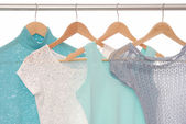 Summery blouses are on coat-hangers. — Stock Photo