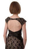 Lace evening dress is on female dorsum — Stock Photo