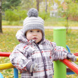 Baby outdoors in autumn on playground — Stock Photo