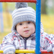 Portrait of baby on playground in autumn — Stock Photo