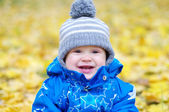 Portrait of smiling baby age of 1 year outdoors in autumn — Stock Photo