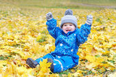 Funny smiling baby age of 1 year outdoors in autumn — Stock Photo