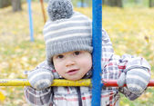 Portrait of baby outdoors in autumn on playground — Stock Photo