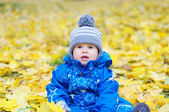 Portrait of lovely baby age of 1 year outdoors in autumn — Stock Photo