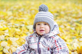 Portrait of lovely baby outdoors in autumn — Stock Photo