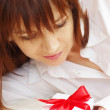 Stock Photo: Portrait of happy beautiful woman with gift box
