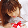 Stock Photo: Portrait of happy young woman with gift box