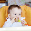 Baby age of 1 year eating bread — Stok fotoğraf