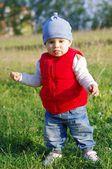 Funny baby walking outdoors — Stock Photo