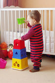 Baby age of 1 year plays nesting blocks at home — Stock Photo