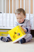 Baby boy age of 1 year plays with toy — Stock Photo