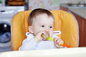 Baby age of 1 year eating bread — Stock Photo