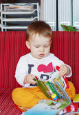 Baby age of 1 year reading book — Stock Photo