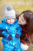 Portrait of mother with baby boy in autumn park — Stock Photo
