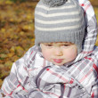 Sad crying baby outdoors in autumn — Stock Photo