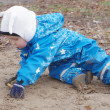 Baby sitting on ground outdoors — Stock Photo