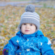 Portrait of lovely baby in gray hat in autumn outdoors — Stock Photo